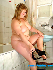 Young plump posing in bathroom
